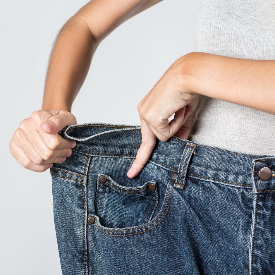 Asianwoman showing big pants, close up